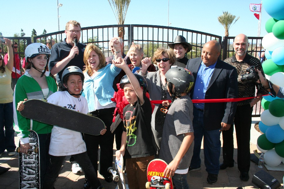 Local skaters help cut the ribbon at the grand opening. City officials pictured: l-r Mayor Frank Ferry, Councilmember Laurie Ender, Parks Commisioner Duane Harte, Mayor Pro Tem Laurene Weste, Councilmember Marsha McLean, Parks Commissioner RuthAnn Levison, Parks Commissioner Ed Redd, City Manager Ken Pulskamp