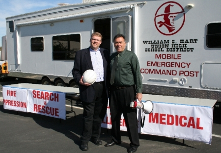 Mayor Frank Ferry with Hart District's Bob Weber in front of the Hart Districts mobile command post.