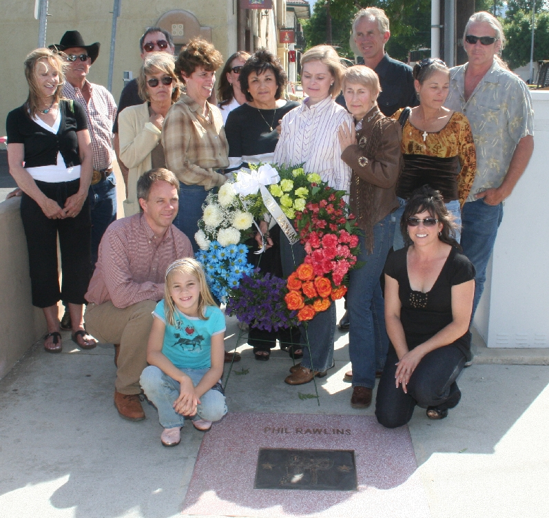 Mayor Pro Tem Laurene Weste and members of Rawlin's family gather at his Bronze Saddle at the Santa Clarita Walk of Western Stars along Market Street