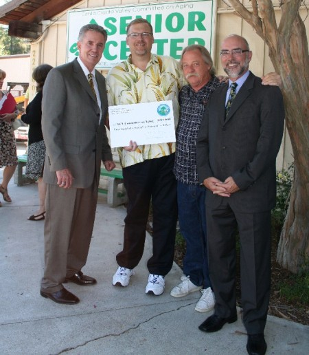l-r: Rick Patterson (President Committee on Aging), Mayor Frank Ferry, Brad Berens (Executive Director, Committee on Aging), City Manager Ken Pulskamp