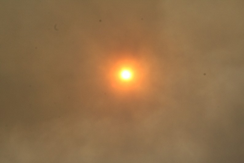 The skies are actually much clearer now than around noon when this picture was taken of the sun in the Canyon Country area.
