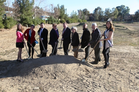 Tierra clad members of the SCV Royal Court flank officials as they break ground.  (L-r): Assistant City Manager Frank Oviedo, Councilmember TimBen Boydston, Mayor Bob Kellar, Councilmember Marsha McLean, Andre Hollings (representing Assemblyman Scott Wilk and Metro CEO Art Leahy.